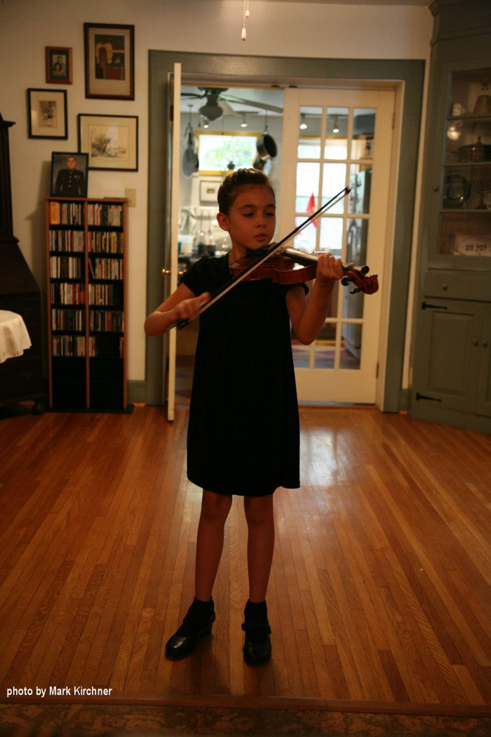 girl in black performing with excellent bow hand