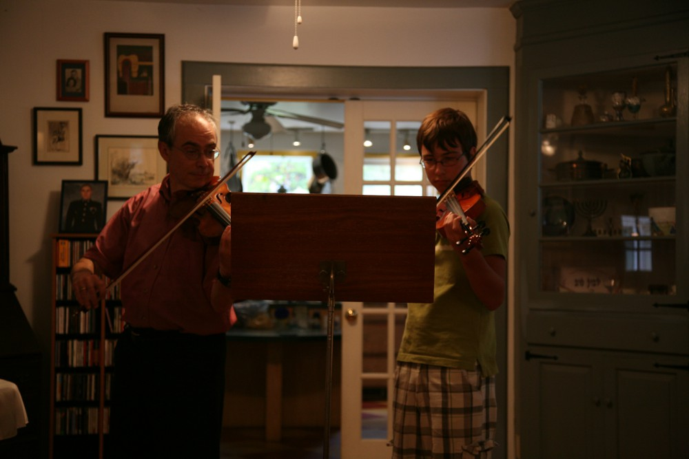 student and teacher performing Bartok Violin Duos together